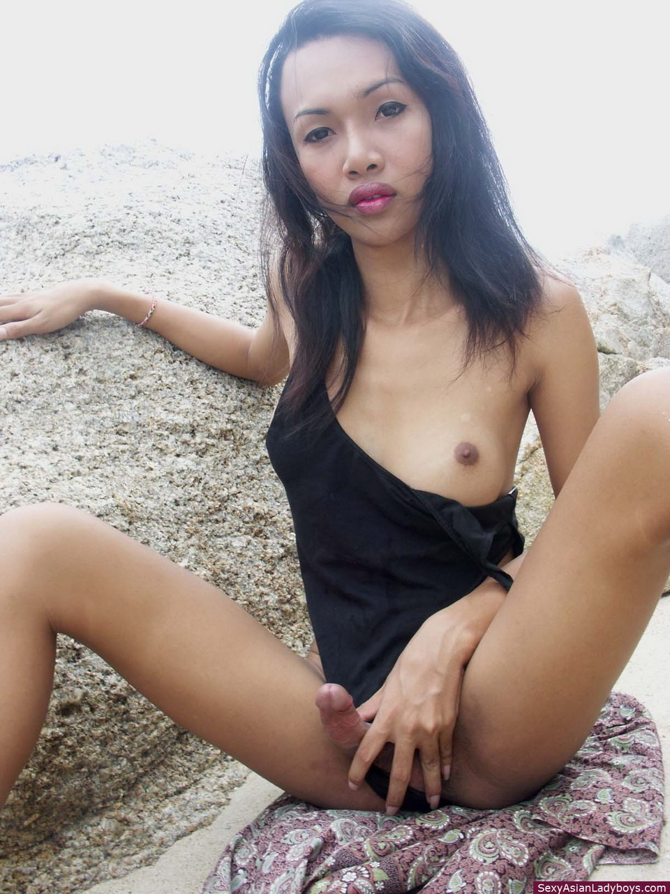 Asian ladyboy playing with nipples and cock 8